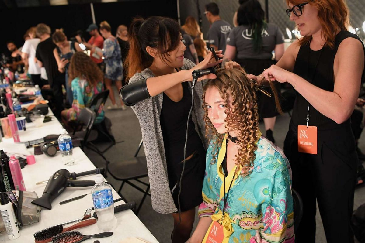 Models get ready backstage for Desigual during the New York Fashion Week on Sept 8, 2016.