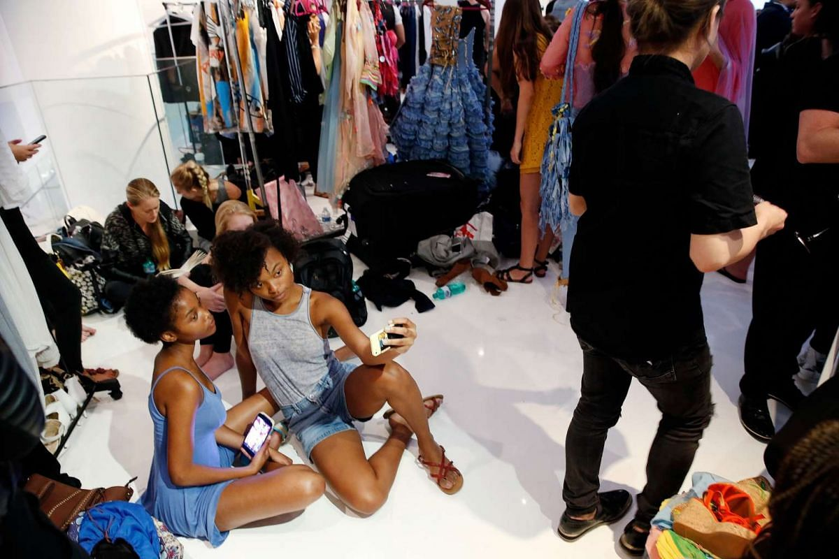 Models prepare backstage before a presentation of the Marlene Spring/Summer 2017 collection during New York Fashion Week in the Manhattan borough of New York, US on Sept 8, 2016.