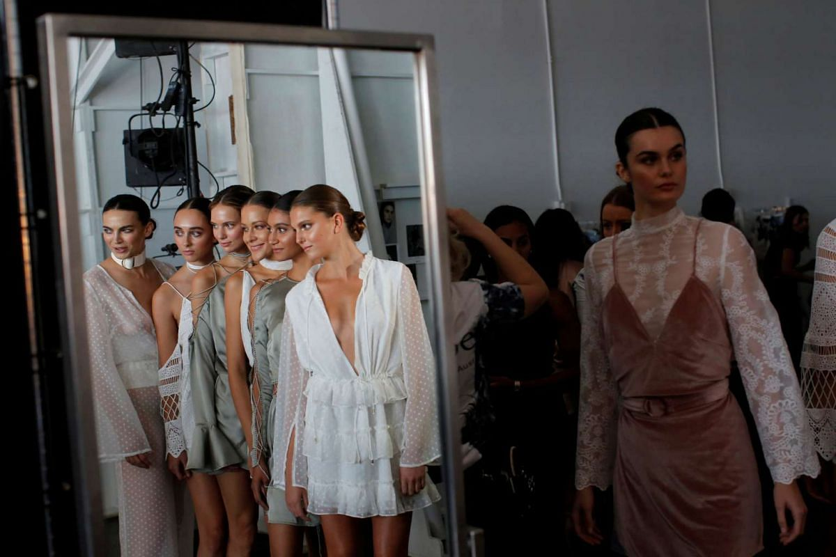 Models are reflected in a mirror as they pose backstage before the Spring/Summer 2017 Fashion Palette show at New York Fashion Week in Manhattan on Sept 8, 2016.