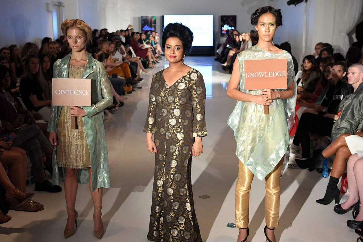 Amruta Fadnavis walks the runway with models during the Chasa IDT at the New York Fashion Week at Space 404 in New York on Sept 8, 2016.
