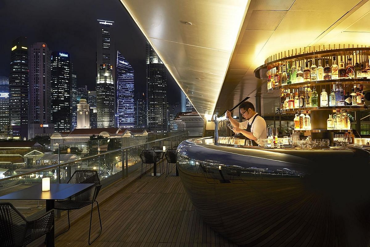 Smoke & Mirrors, on the rooftop of National Gallery Singapore, offers views of the Grand Prix.