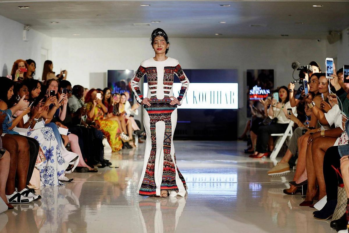 Indian model and acid attack survivor Reshma Quereshi presents a creation from Indian designer Archana Kochhar's collection on Sept 8, 2016.