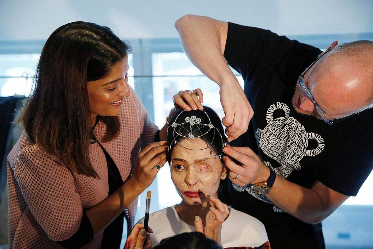 Indian model and acid attack survivor Reshma Quereshi has make up applied before presenting a creation from Indian designer Archana Kochhar's collection on Sept 8, 2016.