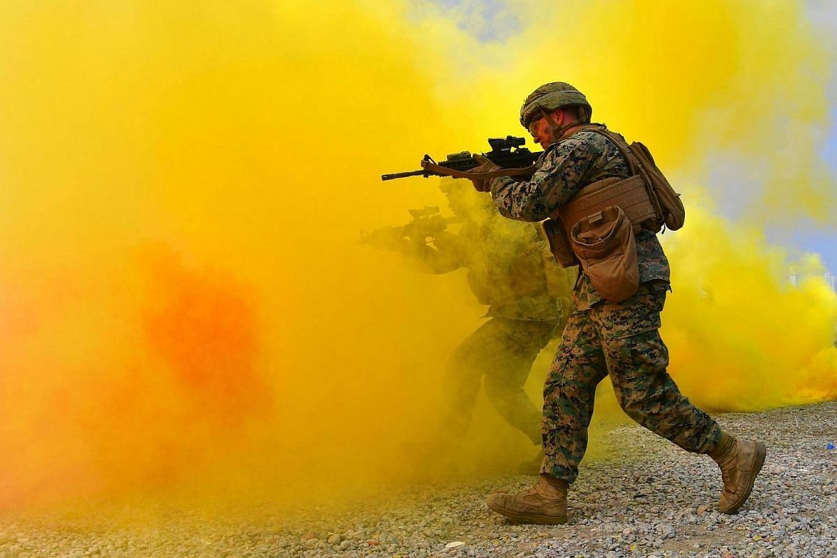 US marines move to a position during a re-enactment of the Incheon landing to mark the 66th anniversary of the start of Operation Chromite, in the western port city of Incheon on Sept 9, 2016.