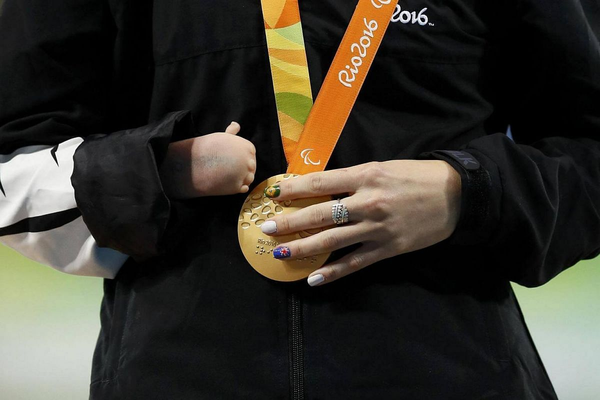 Anna Grimaldi of New Zealand holds her gold medal during the presentation ceremony of the Women's Long Jump T47 final of the Rio 2016 Paralympics Games.