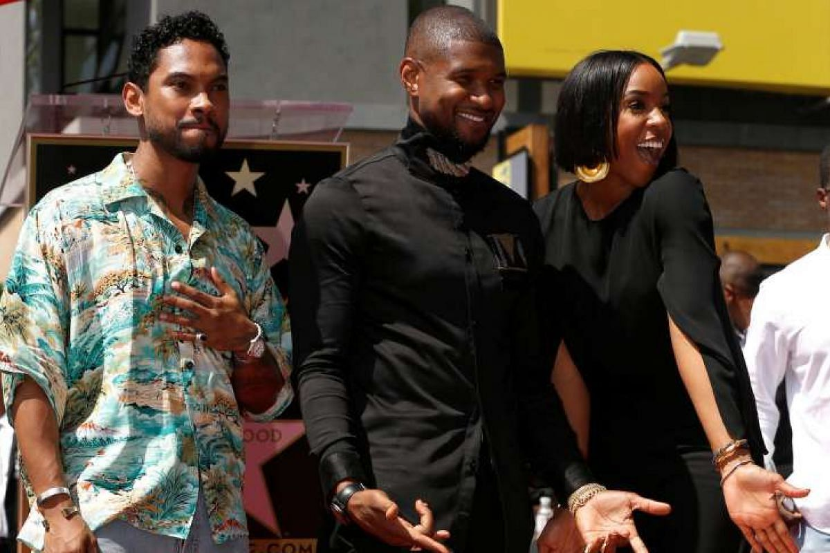 Recording artist Usher (centre) with singers Miguel and Kelly Rowland after the unveiling of Usher's star on the Hollywood Walk of Fame in Los Angeles on Sept 7, 2016.