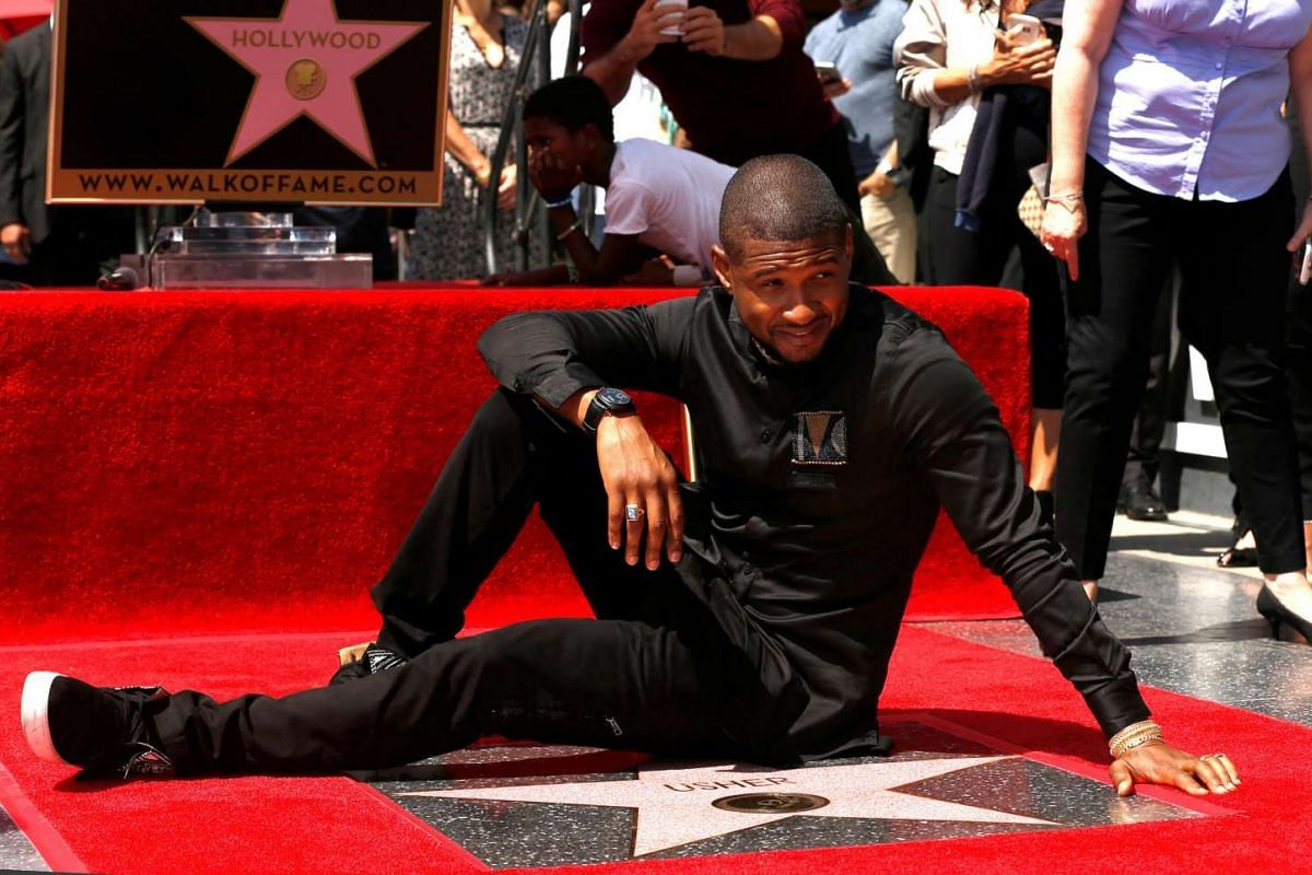 Recording artist Usher poses with his star after it was unveiled on the Hollywood Walk of Fame in Los Angeles, California, on Sept 7, 2016.