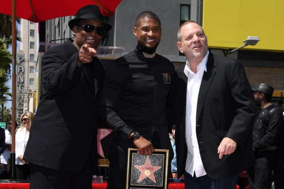 Usher with music producer Terry Lewis (left) and film producer Harvey Weinstein (right) after the unveiling of the singer's star on the Hollywood Walk of Fame in California on Sept 7, 2016.