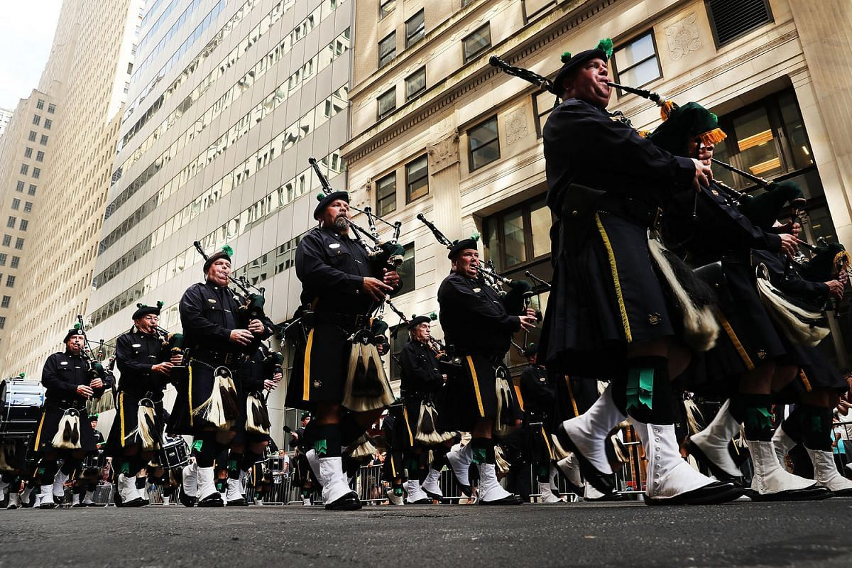 Members of the NYPD Emerald Society Pipes and Drums band march during a procession in Lower Manhattan to mark the 15th anniversary of the 9/11 attacks and the police officers who were killed, on Sept 9, 2016 in New York City.
