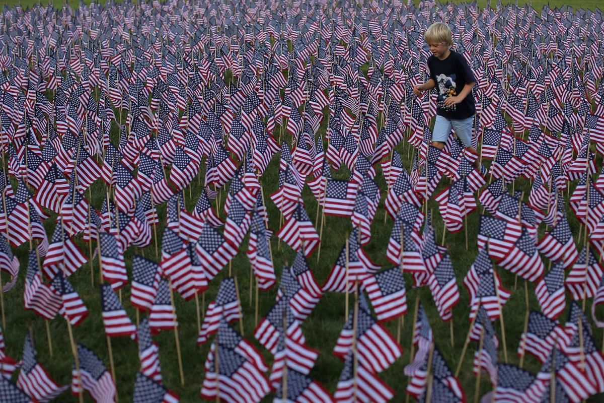 A field of 3,000 U.S. flags was placed in memory of the lives lost in the September 11 attacks, at a park in Winnetka, Illinois, shown here on Sept 10, 2016.