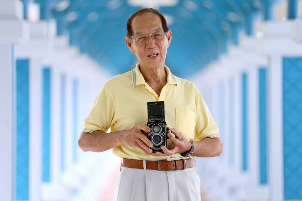 Mr Lui Hock Seng, with the Rolleiflex mechanical camera that his brother bought him 55 years ago.