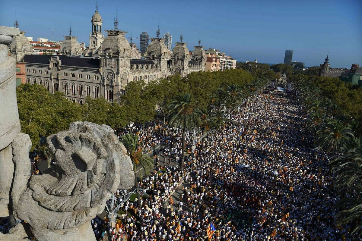 Demonstrators gather during a pro-independence demonstration, on Sept 11, 2016, in Barcelona during the National Day of Catalonia.