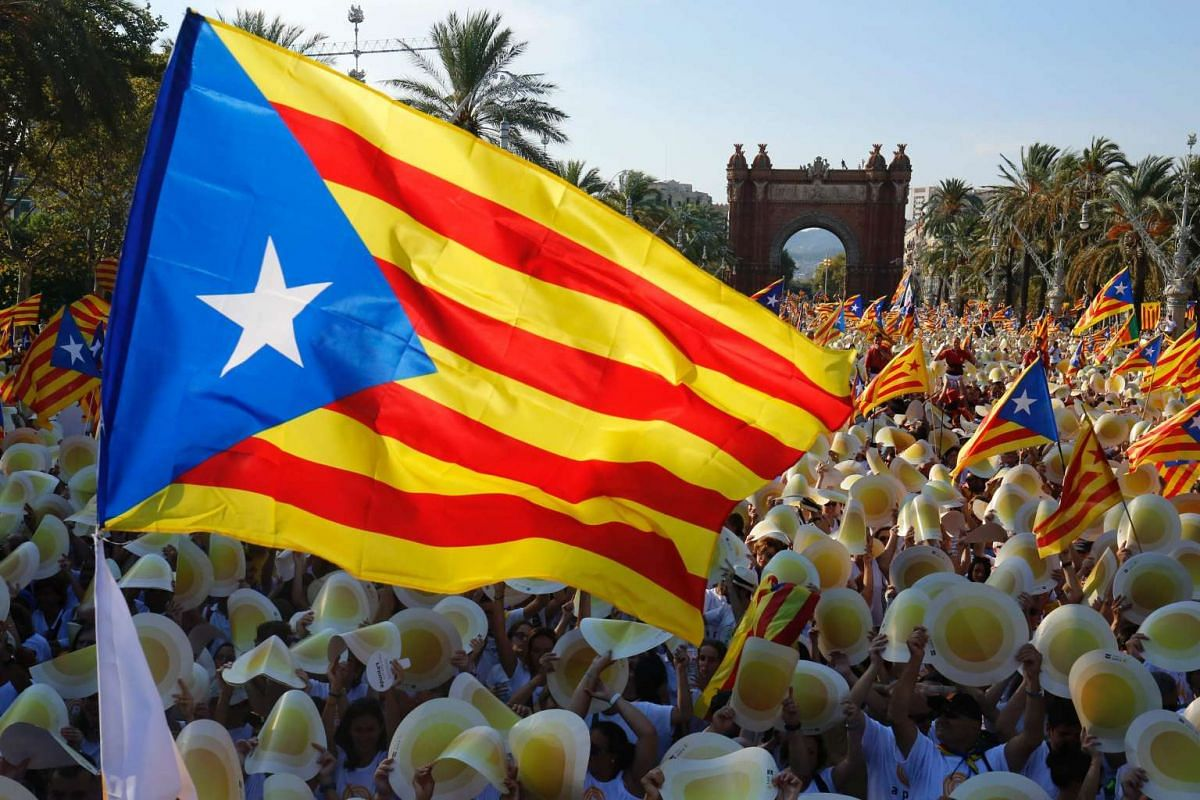 People wave Estaladas (pro-independence Catalan flags) as they gather during a pro-independence demonstration, on Sept 11, 2016, in Barcelona during the National Day of Catalonia.
