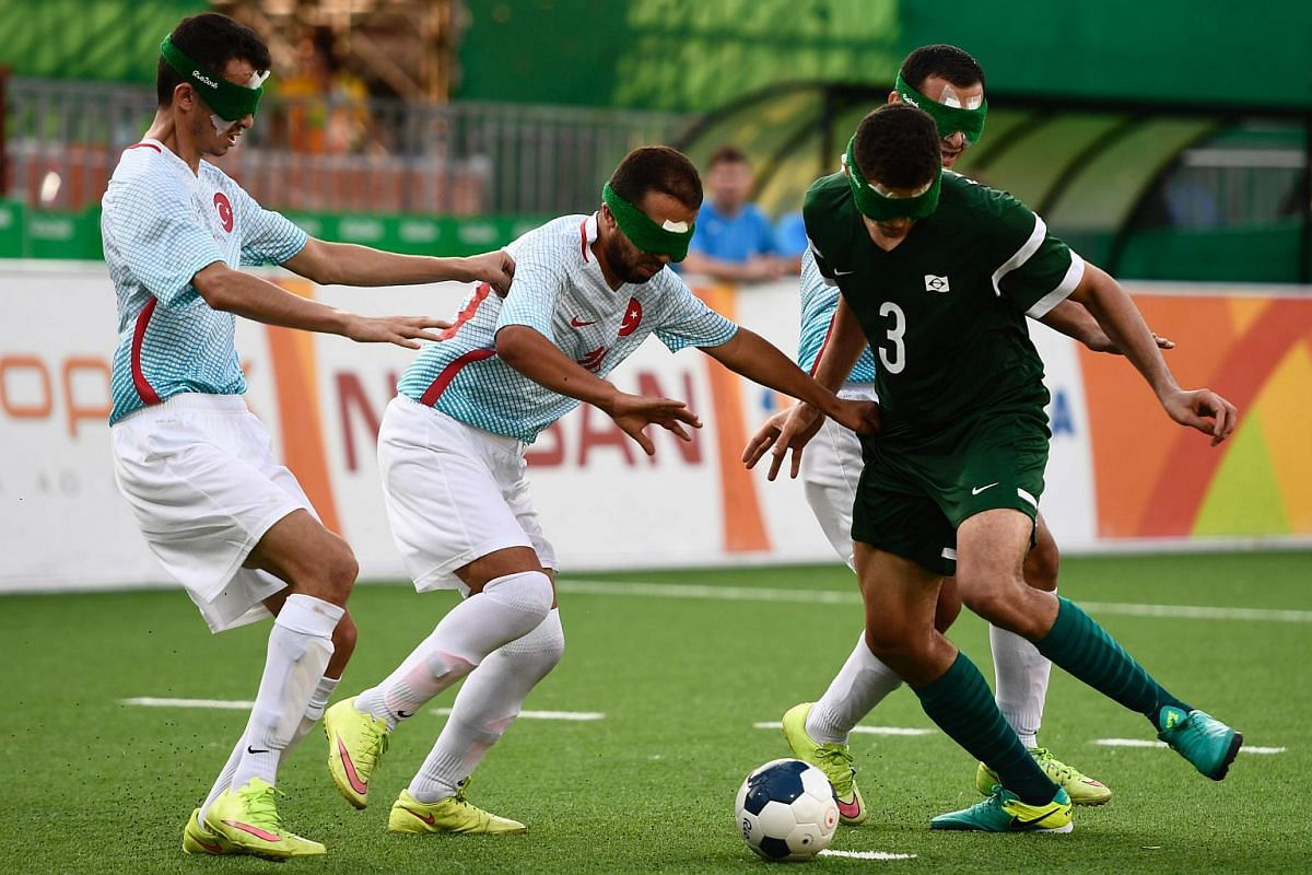 Brazilian Cassio (right) struggles for the ball during their football 5-a-side match Brazil v Turkey, during the Rio 2016 Paralympic Games on Sept 11, 2016.