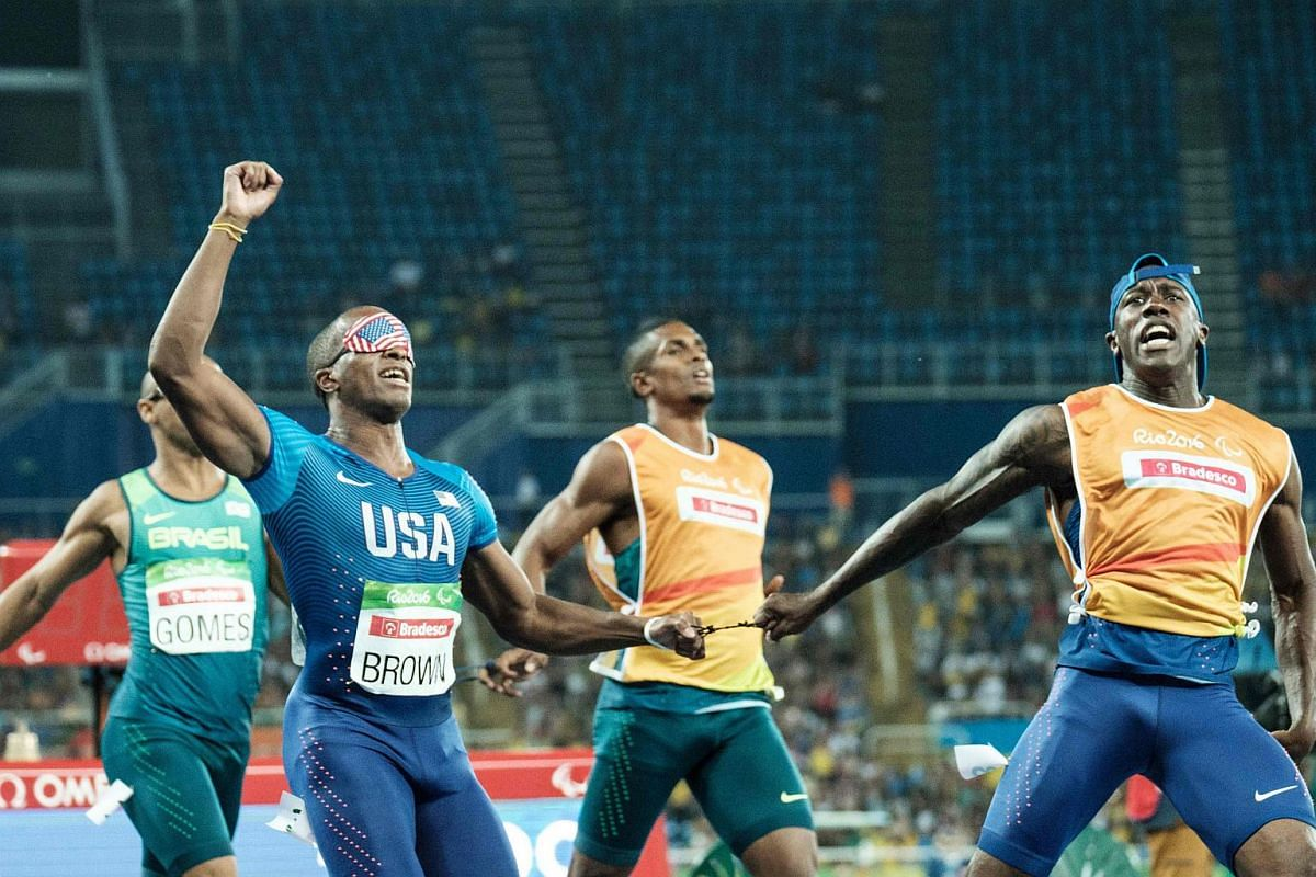 David Brown of the USA (left) reacts with his guide Jerome Avery after winning the men's 100m T11 during the Rio 2016 Paralympic Games at the Olympic stadium on Sept 11, 2016.