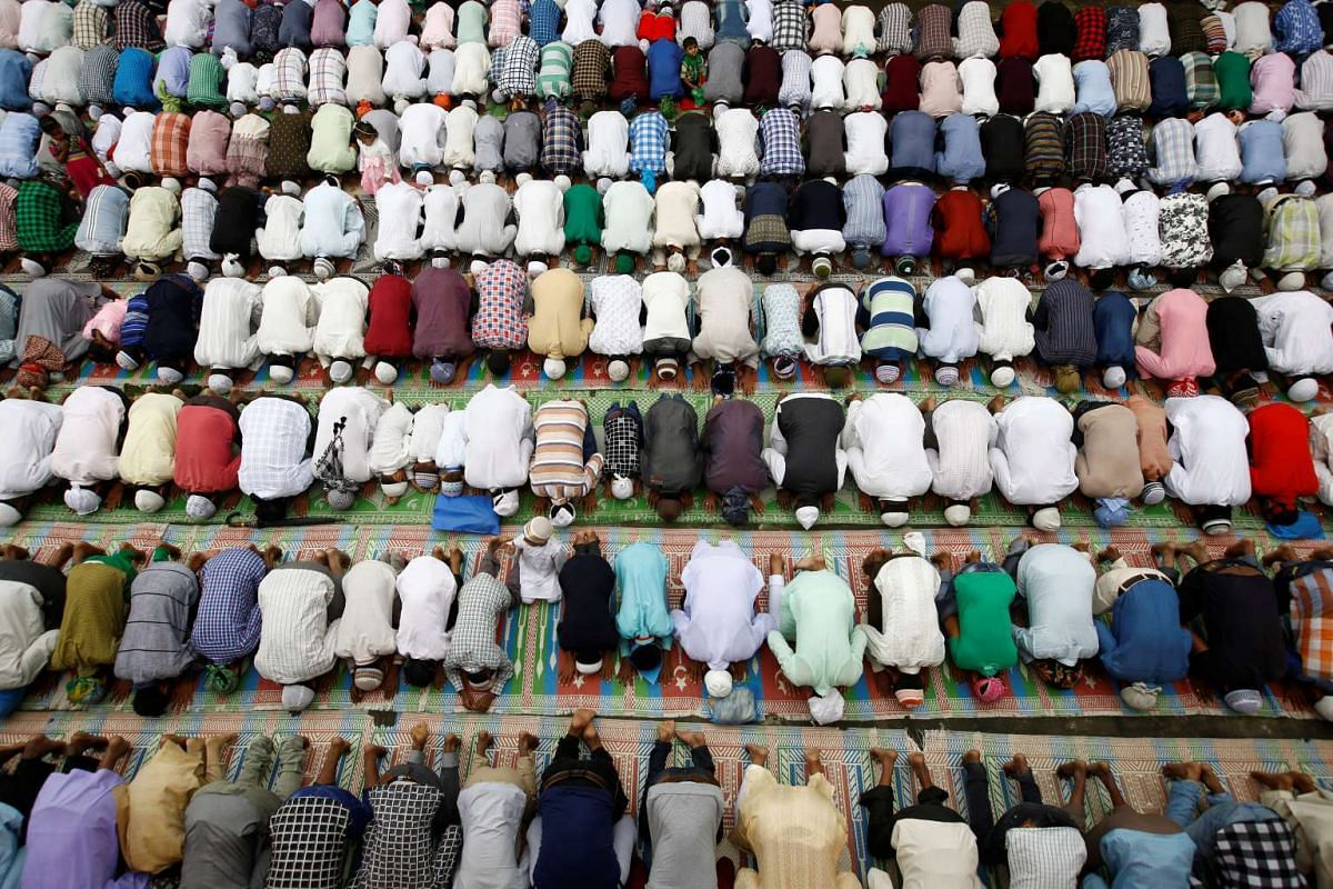 Nepalese Muslims attend the mass prayer during the Eid al-Adha celebrations at the Kashmiri Takiya Jame mosque in Kathmandu, on Sept 13, 2016.
