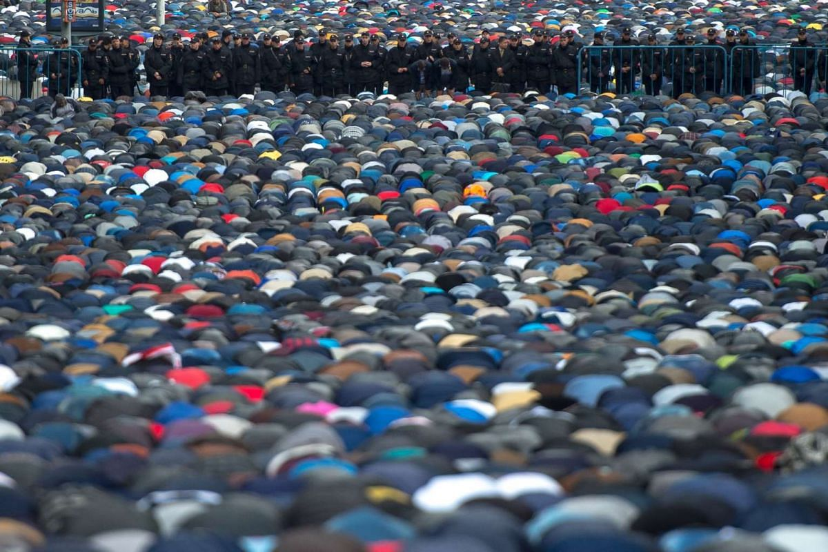 Muslims attend a morning prayer to mark Eid al-Adha in Moscow on Sept 12, 2016.