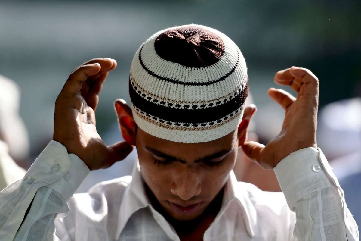 An Indian Muslim offers Eid al-Adha prayers at a mosque in New Delhi on Sept 13, 2016.