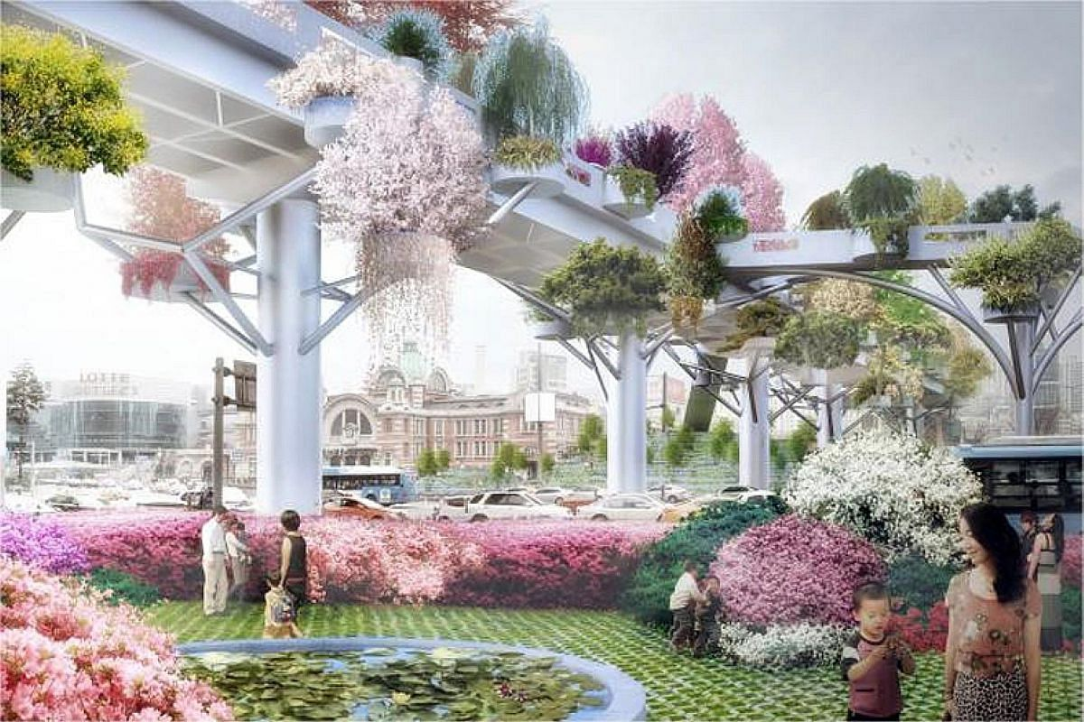 Above: The busy highway before it was closed prior to its transformation into the Seoul Skygarden. Left: An artist's impression of what the garden will look like. Mayor Park Won Soon unveiling a mock-up of a section of the Seoul Skygarden project in