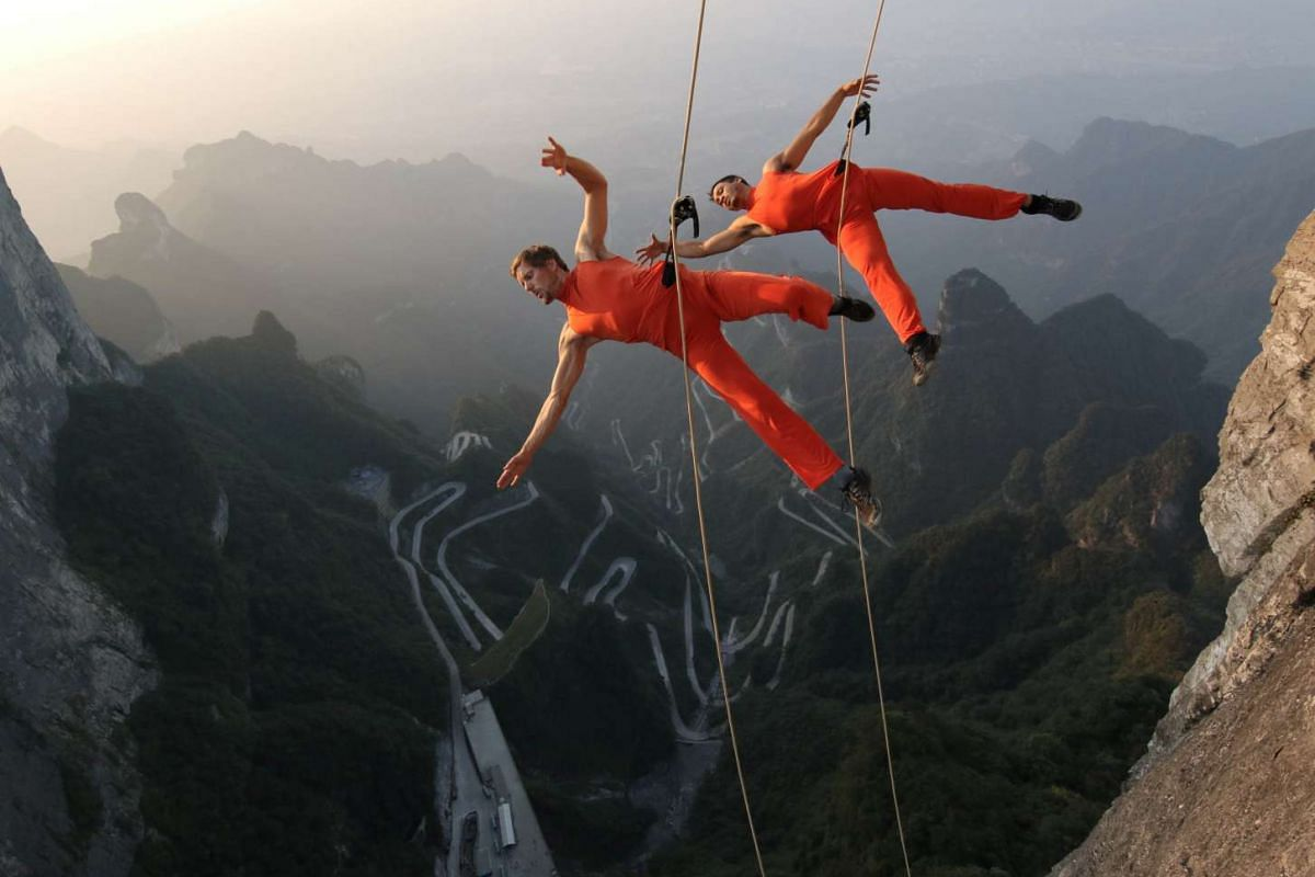 A handout photo released on September 13, 2016, shows a dance group performing on the cliffs in Zhangjiajie, Hunan province, China September 11, 2016. PHOTO: REUTERS/CHINA DAILY