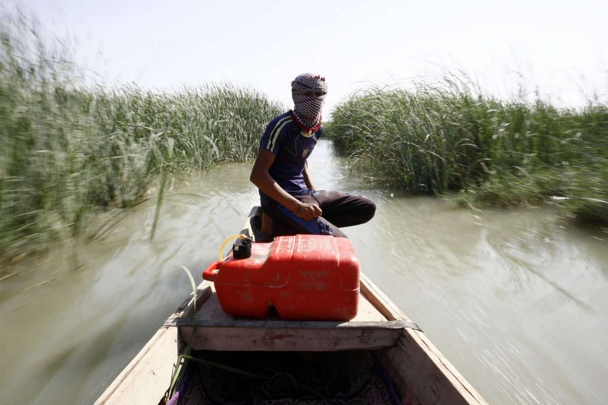 An Iraqi man rides a boat in the Chibayish marshes near the southern Iraqi city of Nassiriyah on September 13, 2016. UNESCO has named Iraqi marshlands once ravaged by dictator Saddam Hussein, as a World Heritage Site.  PHOTO: AFP