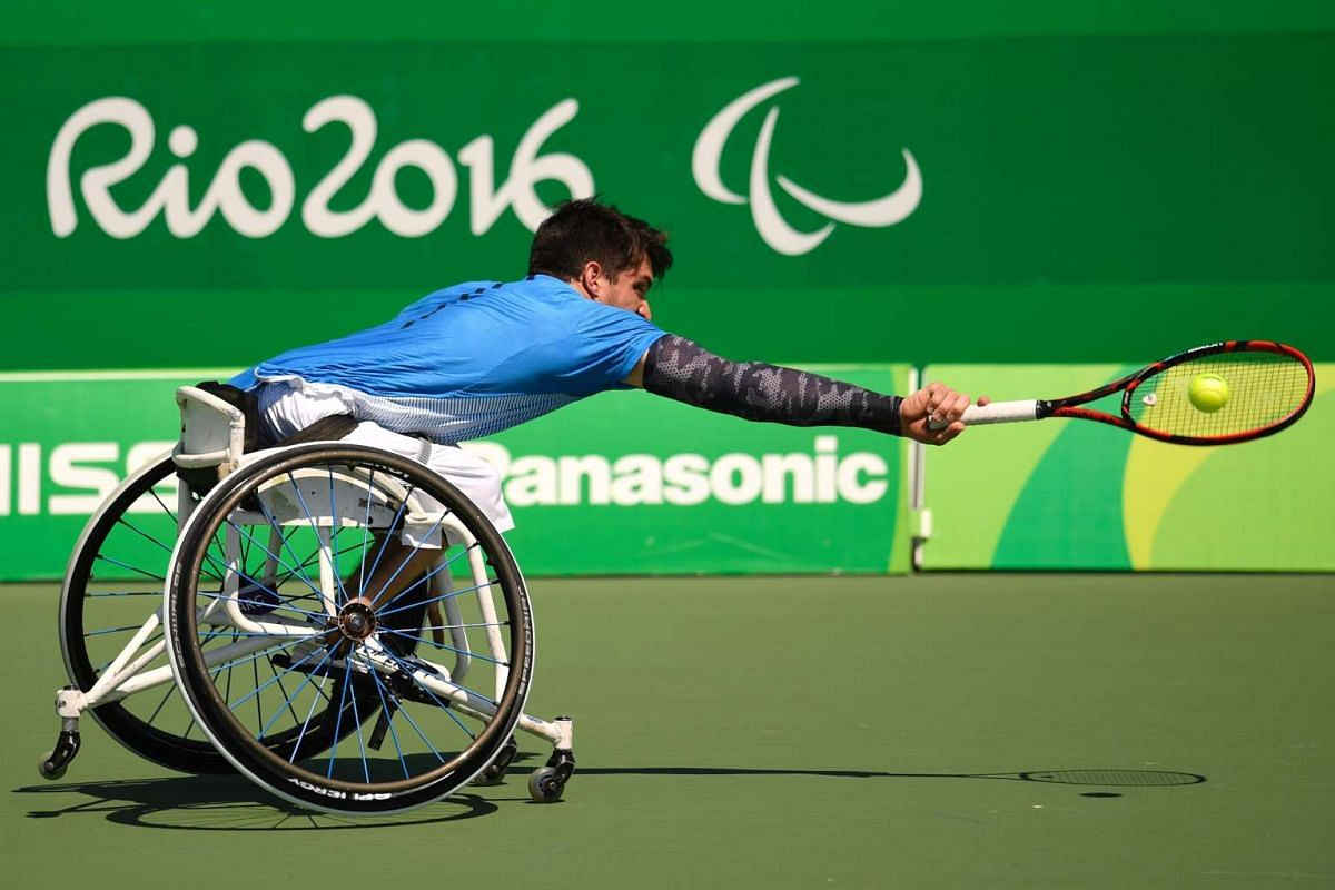 Argentina's Gustavo Fernandez returns the ball to Great Britain's Gordon Reid during their Wheelchair Tennis match at the Olympic Tennis Centre during the Rio 2016 Paralympic Games in Rio de Janeiro, Brazil, on September 13, 2016. PHOTO: AFP