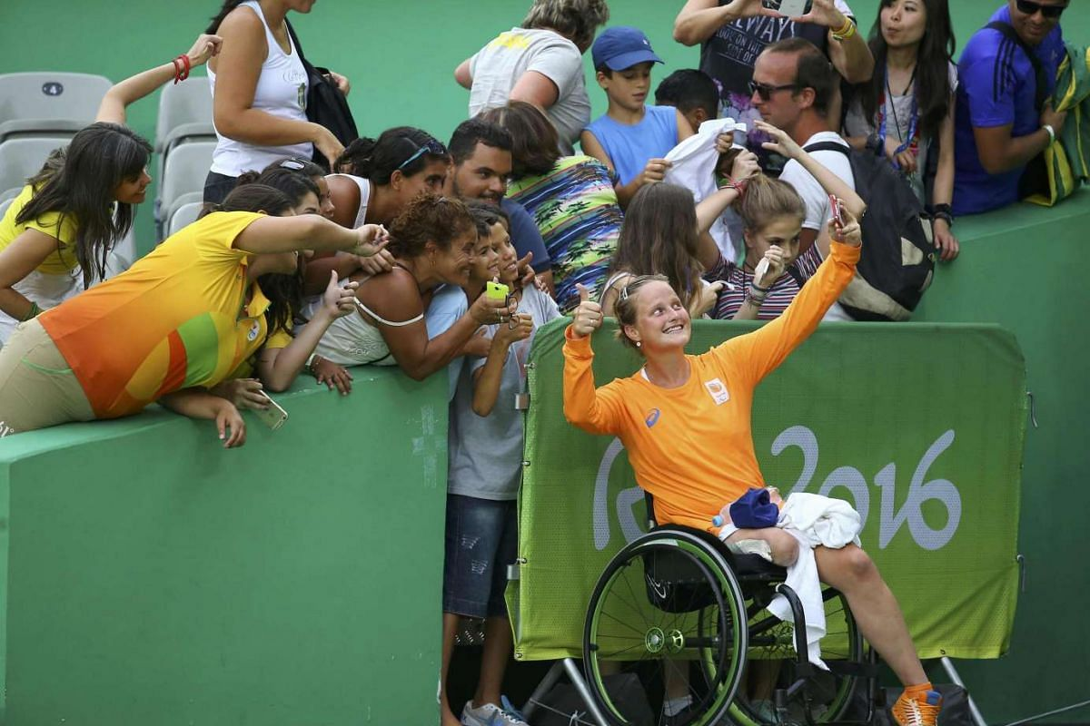 Aniek van Koot of the Netherlands takes a selfie with fans during the wheelchair tennis semi-final on Sept 13, 2016.