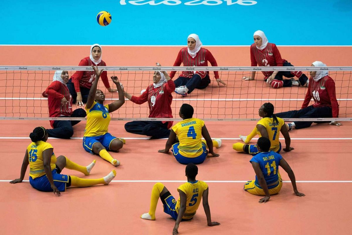 Rwanda (front) plays Iran in a sitting volleyball women's preliminaries pool B match for the Paralympic Games, in Rio de Janeiro, Brazil, on Sept 12, 2016.