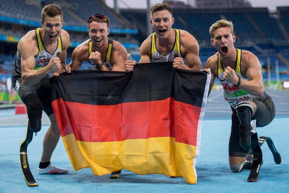 Germany's Markus Rehm (T44), David Behre (T43), Felix Streng (T44) and Johannes Floors (T43) pose for a photo after winning the gold medal in the men's 4x100m on Sept 12, 2016.