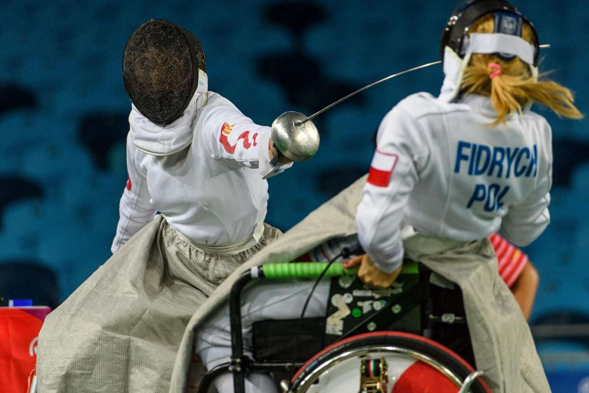Marta Fidrych (right) of Poland and Jing Bian China in the women's individual epee preliminary pool match at the Rio 2016 Paralympic Games on Sept 13, 2016.