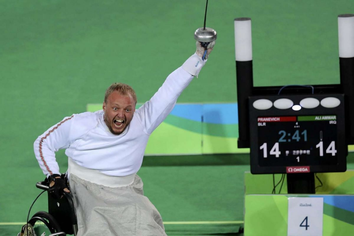 Andrei Pranevich of Belarus celebrates winning a gold medal for wheelchair fencing at Rio Paralympics on Sept 13, 2016.