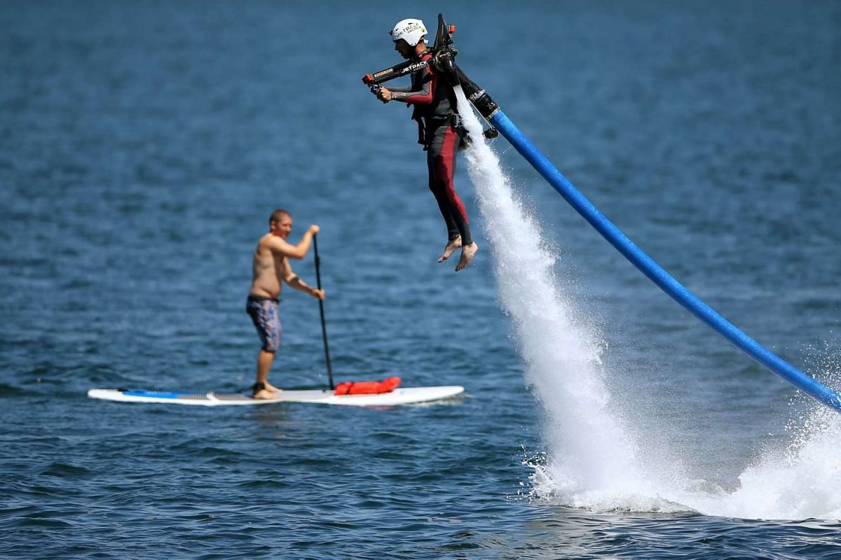 U.S. military veteran Joshua Alves shoots out of the ocean on a water jetboard as part of an event by Warrior Passion, a charity that helps adjusting U.S. veterans, and Jetpack America to assist veterans in overcoming their challenges through shared