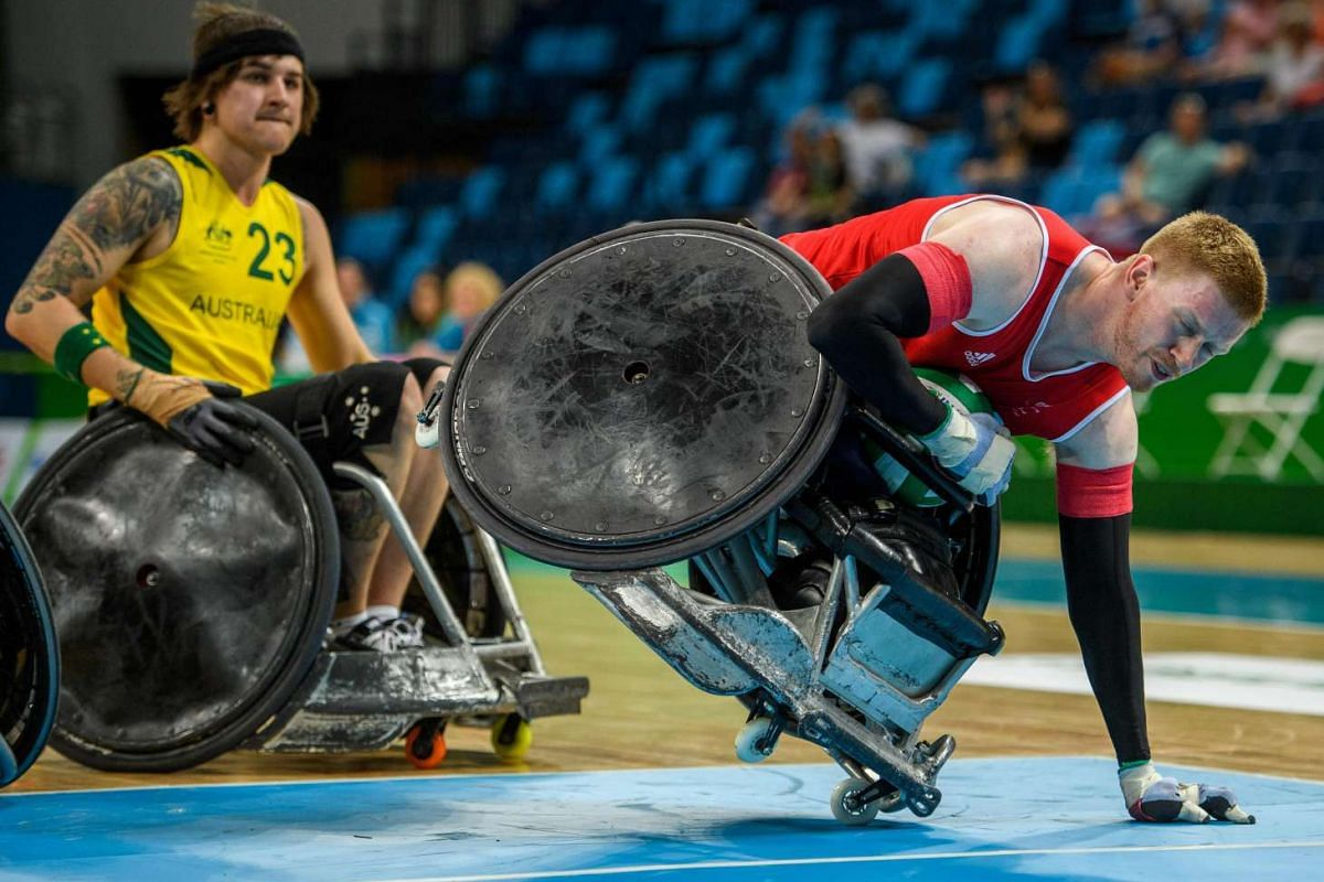 A handout photo shows Jim Roberts GBR going into the scoring zone with the ball on one wheel in the Australia vs Great Britain Pool Phase Group A, Match 01 Wheelchair Rugby at the Carioca Arena 1, during the Paralympic Games, in Rio de Janeiro, Brazi