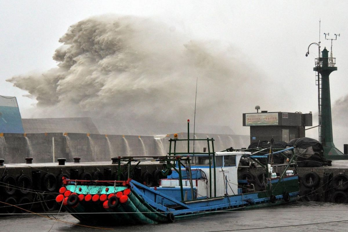 This photo by Taiwan agency CNA Photo shows a huge wave breaking over port infrastructure as Super Typhoon Meranti lashes a fishing port in southern Taitung county on Sept 14, 2016.