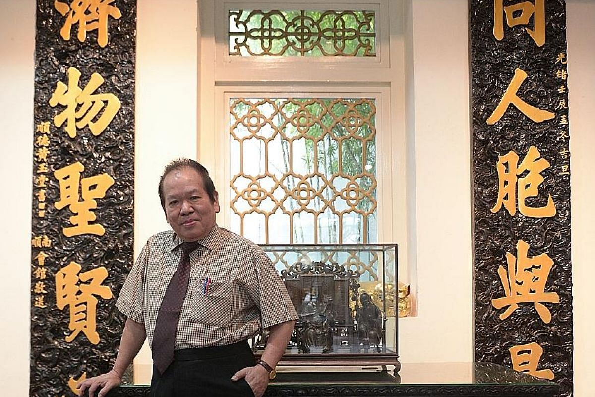 Left: Mr Chong Shaw Fong, 69, has fond memories of the year he spent working as a traditional Chinese medicine physician in the former Thong Chai Medical Institution over four decades ago. Behind him is a pair of black and gold parallel couplets whic