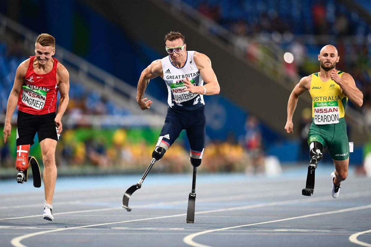 Australia's Scott Reardon (R), Denmark's Daniel Wagner (L) and the UK's Richard Whitehead compete in the 100M during the Paralympic Games in Rio de Janeiro, Brazil on September 15, 2016. PHOTO: AFP