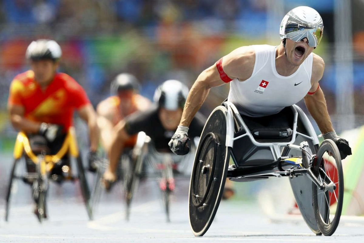 Marcel Hug of Switzerland (R) competes en route to a gold medal finish in the men's 800m - T54 final during the Rio 2016 Paralympic Games in Rio de Janeiro, Brazil, September 15, 2016. PHOTO: REUTERS