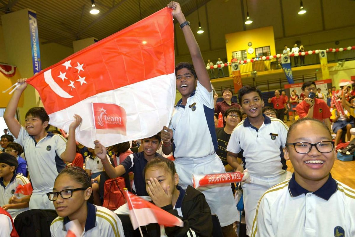 Students at Bendemeer Secondary School, where para-swimmer Yip Pin Xiu is an alumni, cheer as Yip races in the 2016 Rio Paralympics 50m backstroke final, September 16, 2016. She won gold for the event. PHOTO/STRAITS TIMES/NG SOR LUAN