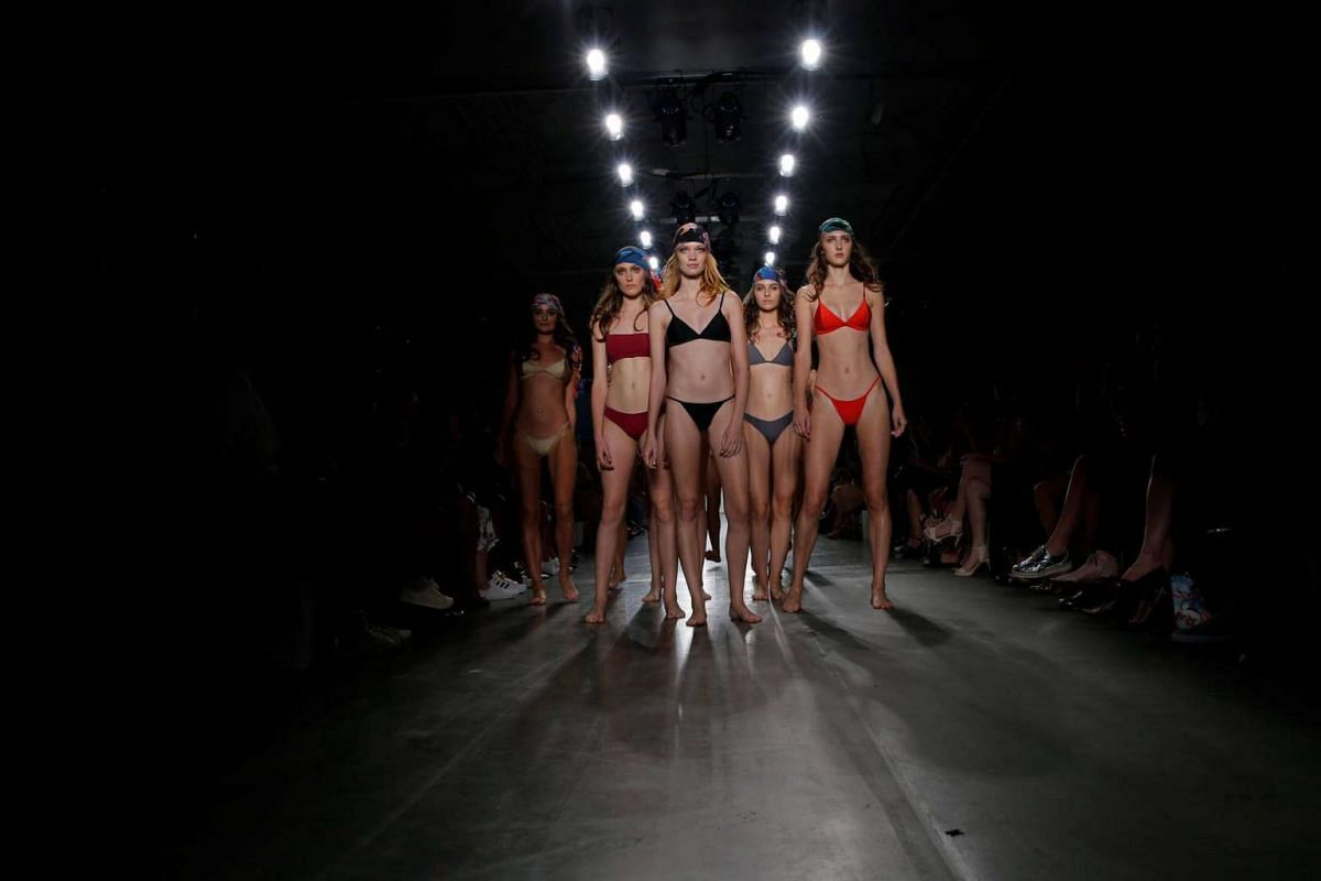 Models present creations from the Frankie Swimwear Spring/Summer 2017 collection at New York Fashion Week on Sept 8, 2016.