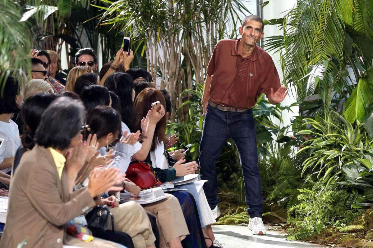 Designer Felipe Oliveira Baptista waves to the audience at the Lacoste show at New York Fashion Week on Sept 10, 2016.