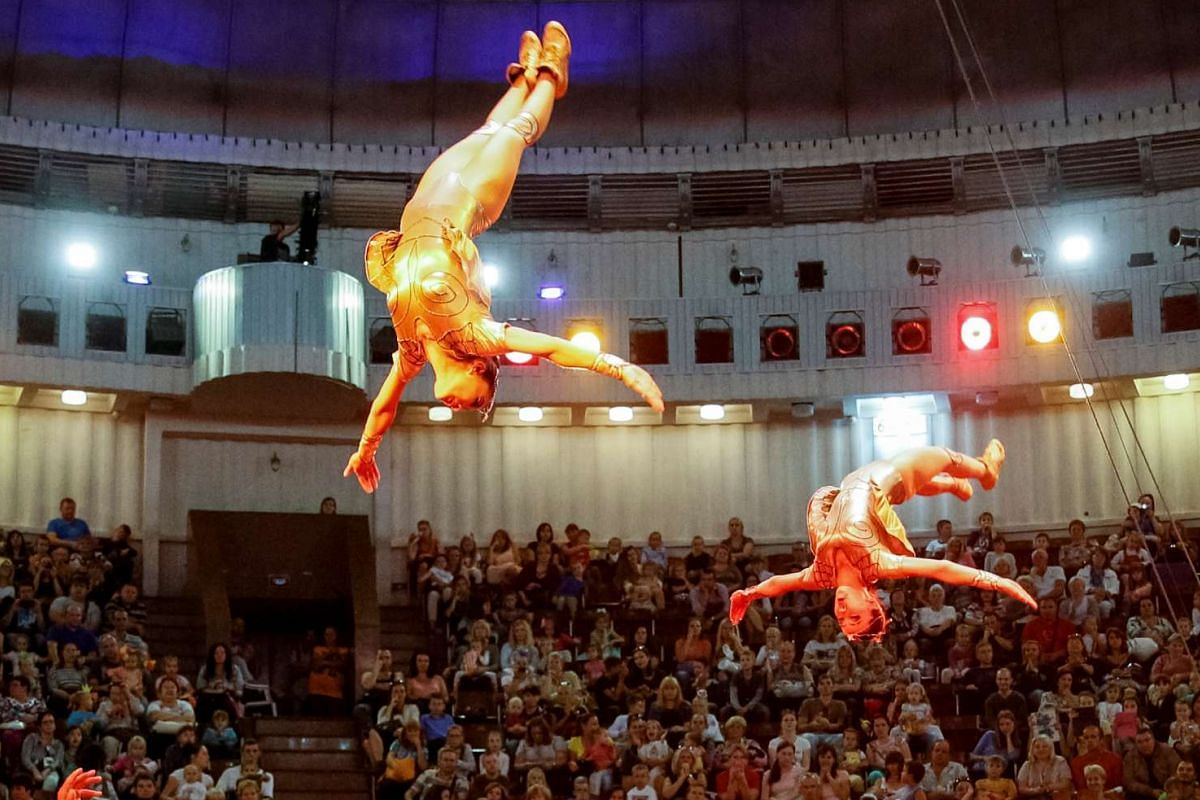 Acrobats perform during the presentation of the new show The Extreme Arena at the National Circus in Kiev, Ukraine on Sept 15, 2016.
