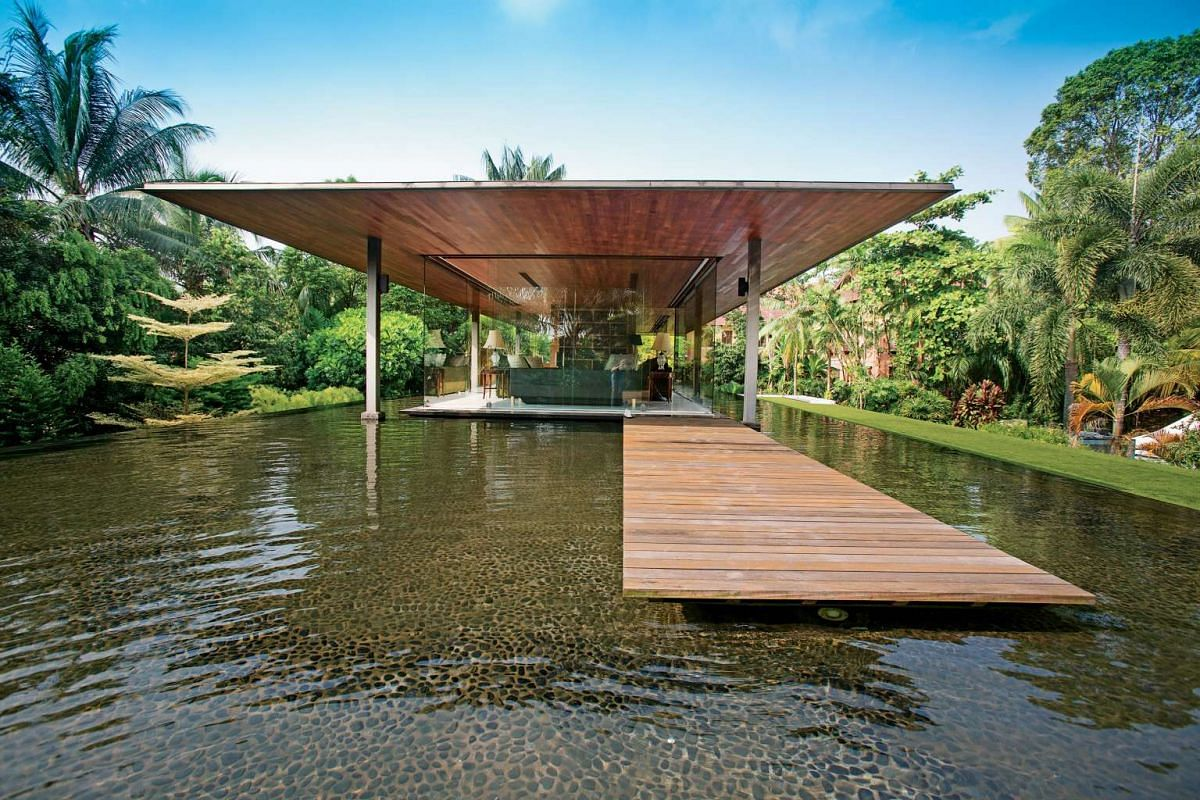 The tree-lined drive to the Water-Cooled House, with its rooftop pond that surrounds a glass pavilion (above).