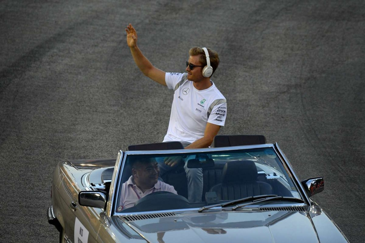 Nico Rosberg of Germany waves to the crowd during the drivers parade ahead of the 2016 Formula One Singapore Airlines Singapore Grand Prix at the Marina Bay street circuit on Sept 18, 2016.