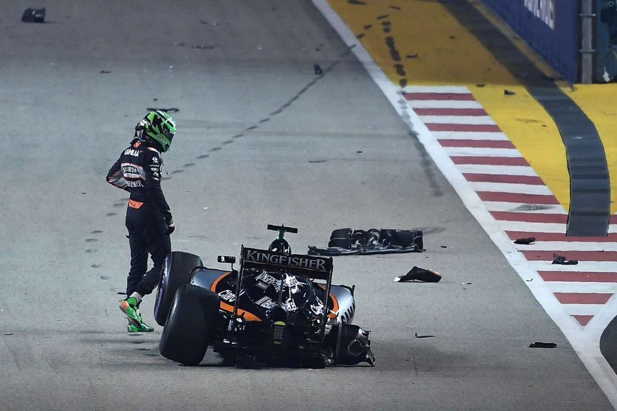 Nico Hulkenberg leaves his car after crashing during the start of the 2016 Formula One Singapore Airlines Singapore Grand Prix on Sept 18, 2016.