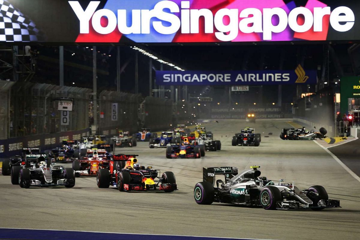 Nico Rosberg leading the pack as Nico Hulkenberg (rear right) crashes out during the night race of the 2016 Formula One Singapore Airlines Singapore Grand Prix at the Marina Bay Street Circuit on Sept 18, 2016.