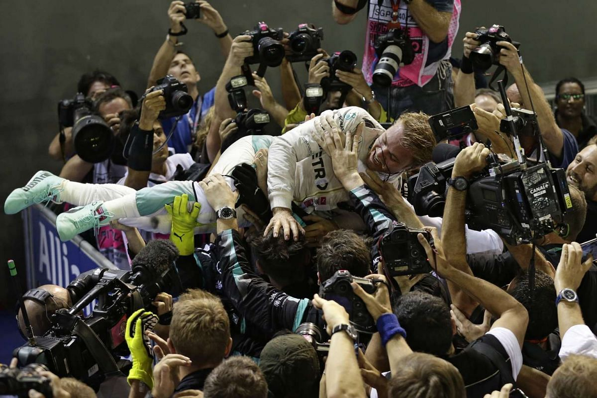 Nico Rosberg of Germany celebrating with his team after winning the night race of the 2016 Formula One Singapore Airlines Singapore Grand Prix at the Marina Bay Street Circuit on Sept 18, 2016.