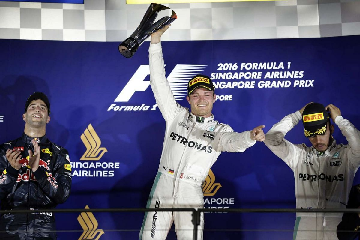 Nico Rosberg of Germany holds the trophy aloft after winning the night race of the 2016 Formula One Singapore Airlines Singapore Grand Prix at the Marina Bay Street Circuit on Sept 18, 2016.