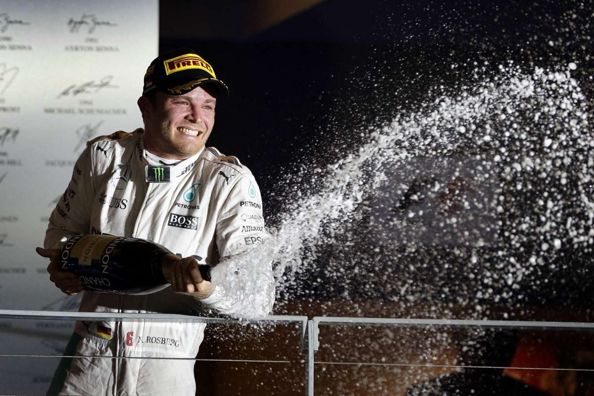Nico Rosberg of Germany spraying champagne after winning the night race of the 2016 Formula One Singapore Airlines Singapore Grand Prix at the Marina Bay Street Circuit on Sept 18, 2016.