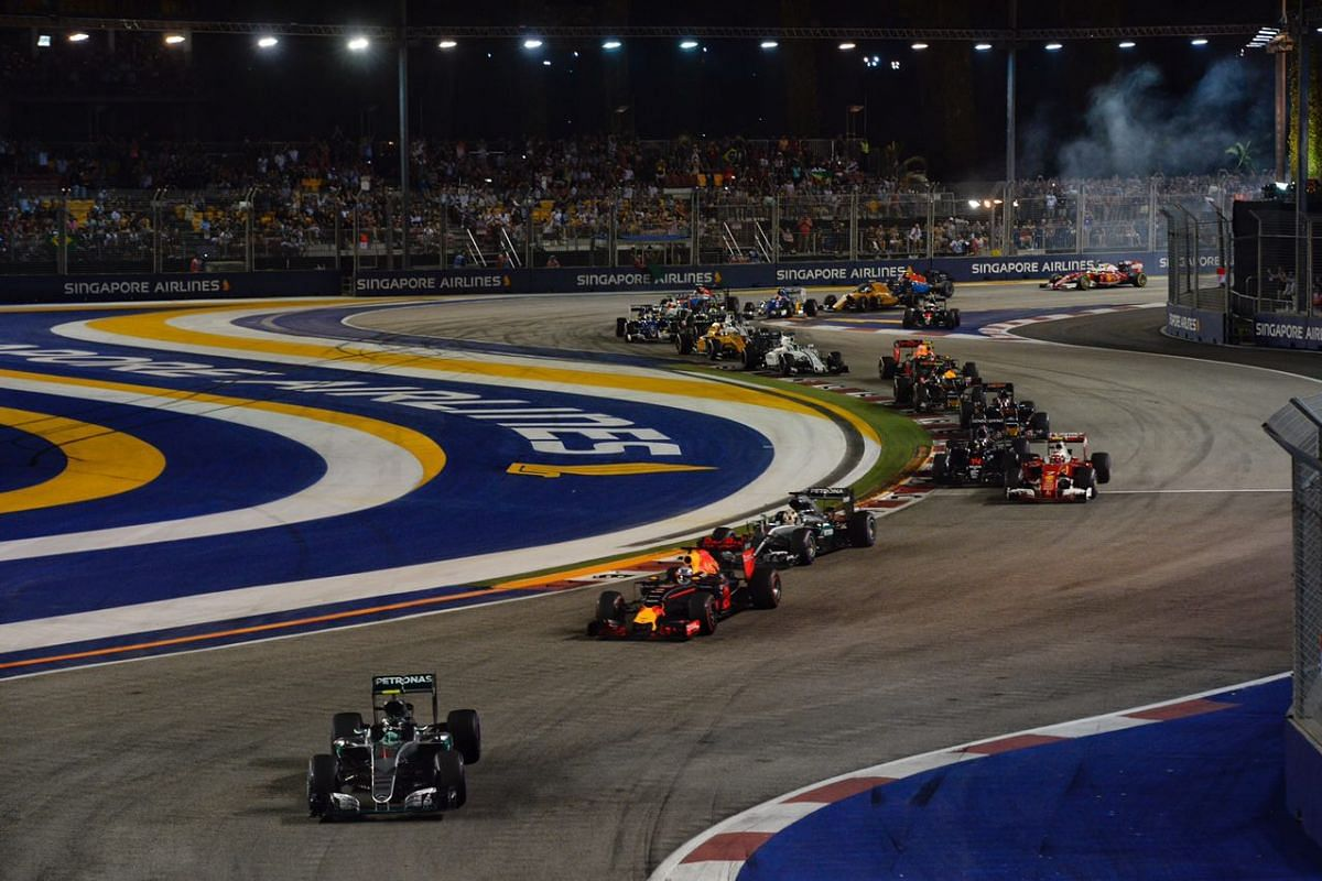 Mercedes AMG Petronas driver Nico Rosberg follows a safety car while Sahara Force India driver Nico Hulkenberg's car is cleared by safety marshals after it crashed.