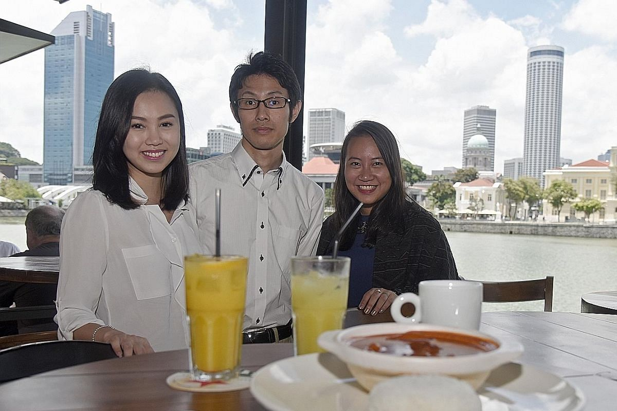 From far left: Ms Hazel Kweh, Mr Allan Tanekura and Ms Sara Cao use Lunch Kaki, an app that links strangers so they do not have to dine alone.